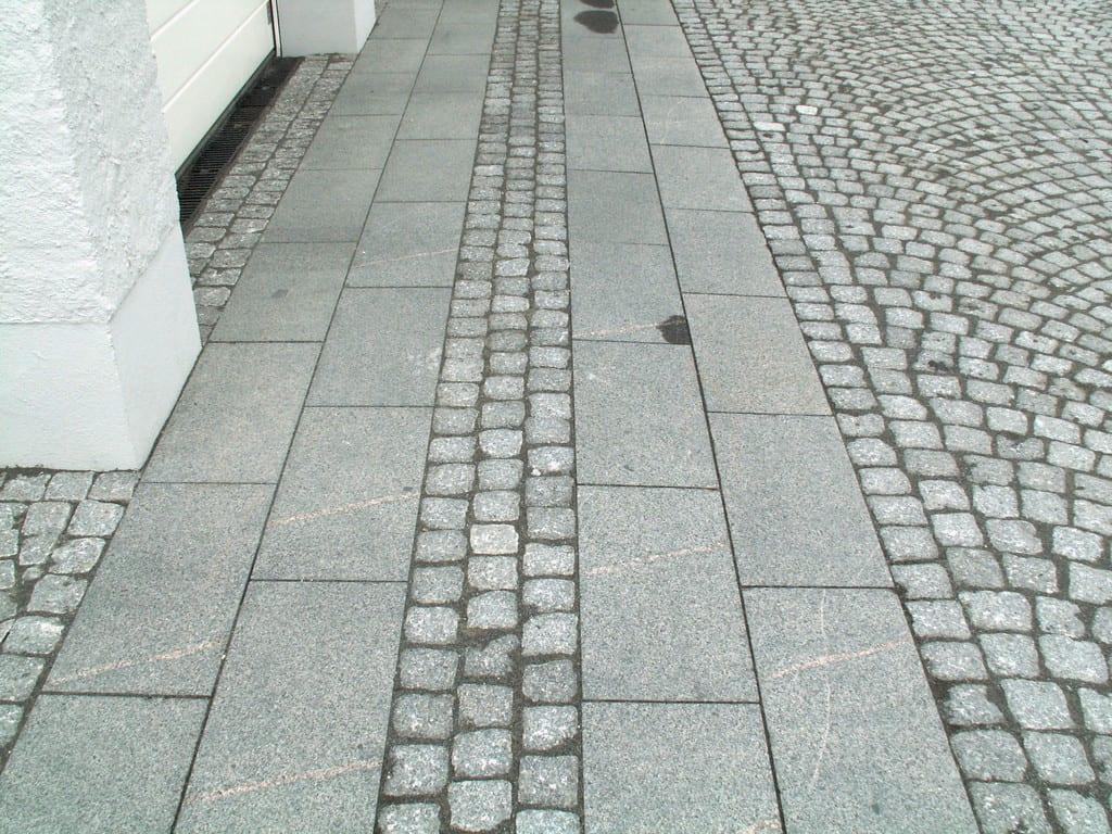 Granit fliser og chaussésten's belægning